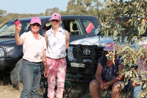 Belinda Bennet and Chrissie Ashby. Belinda shows off the ultimate must-have accessory on Pink Stumps Day - a pink stubby holder!