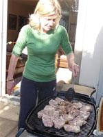 Janie throws the Fitzpatrick's biodynamic Lamb chops on the barbie