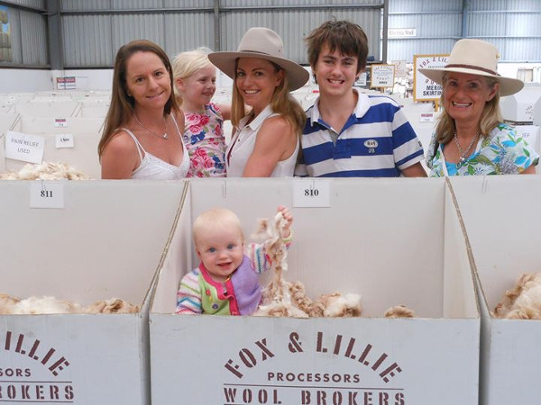 """Selling wool into a rising market at auction and the next generation """"getting immersed in wool """" – a good day out! From left to right: Alice McClure, Amelia Stephens, Grace McClure, Billy Stephens, Janie McClure and Grace Ainsworth (immersed in wool!)"""